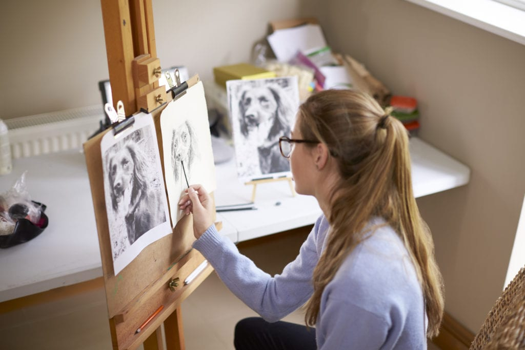 Student working on portrait of her pet dog