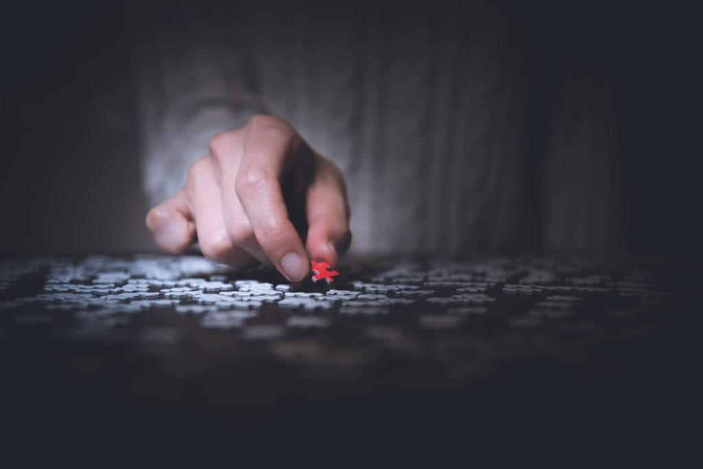 A person working on solving a puzzle